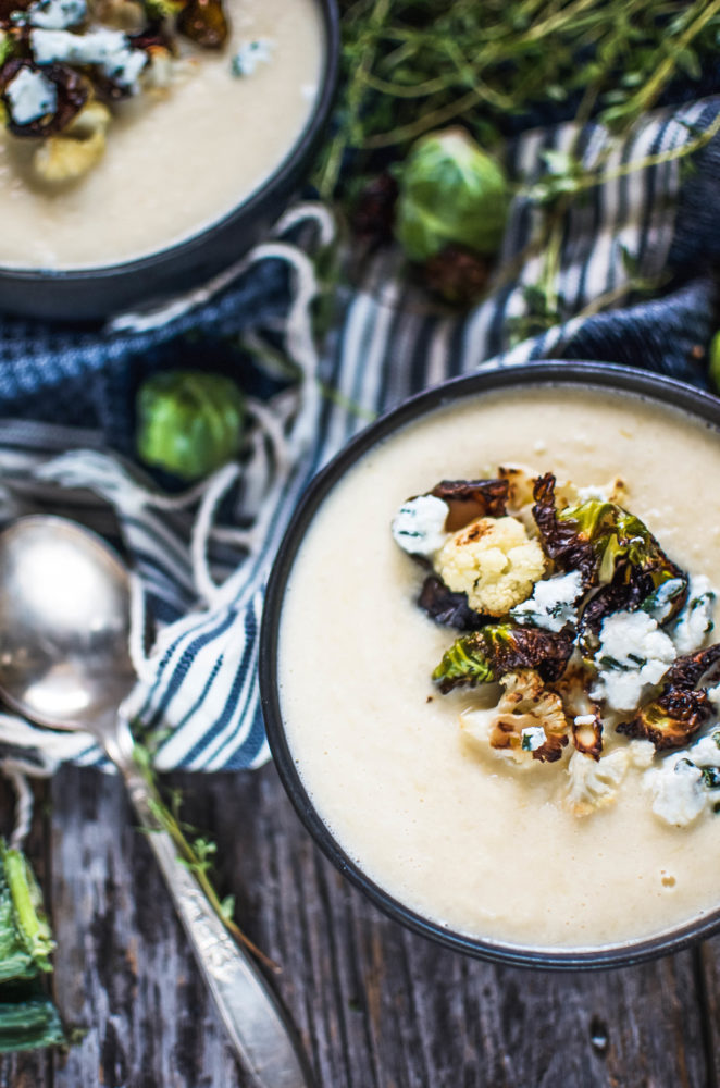 A decadent, rich cauliflower soup topped with crispy Brussels sprout leaves, cauliflower florets and herbed goat cheese.