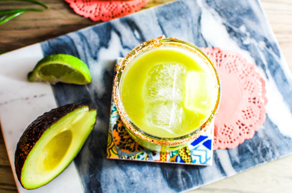 This avocado margarita recipe is perfect to drink all year round, but better enjoyed on a patio in the summer.